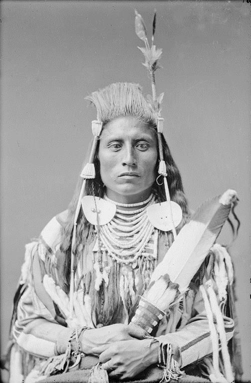 Close-up of Medicine Crow from a group photo.